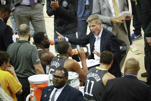 Golden State Warriors' head coach Steve Kerr talks to his team in the first quarter during game 4 of the Western Conference Finals between the Golden State Warriors and the Houston Rockets at Oracle Arena on Tuesday, May 22, 2018 in Oakland, Calif.