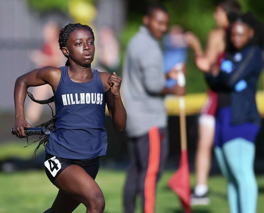 Hillhouse freshman Nyia White runs the first leg of the 4x400 meter relay at the SCC track and field championship, Wednesday, May 23, 2018, at Amity Regional High School. White and her teammates, juniors Jada Boyd, De' Janay Davis and Nyimah Ambrose won the event in  3:59.59. Photo: Catherine Avalone, Hearst Connecticut Media / New Haven Register