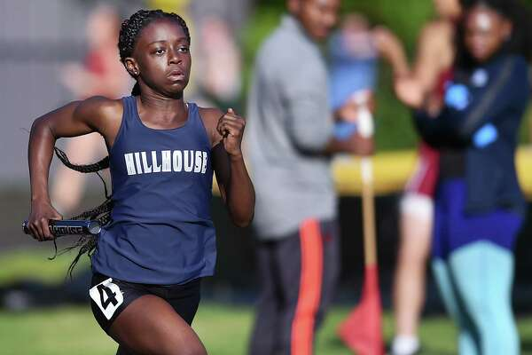 Hillhouse freshman Nyia White runs the first leg of the 4x400 meter relay at the SCC track and field championship, Wednesday, May 23, 2018, at Amity Regional High School. White and her teammates, juniors Jada Boyd, De' Janay Davis and Nyimah Ambrose won the event in  3:59.59.