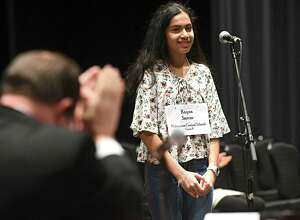 """Eighth grader Ryana Sarcar, 14, of Niskayuna, spells the word """"plenary"""" to win the 36th Annual Capital Region Spelling Bee at Proctors Theatre on Tuesday, Feb. 13, 2018 in Schenectady, N.Y. Sarcar will advance to the 91st Scripps National Spelling Bee in Washington D.C. in May. (Lori Van Buren/Times Union)"""