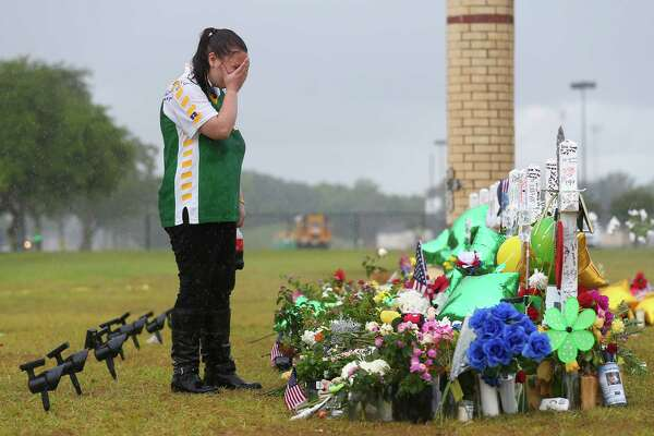 Sierra Dean, 16, grieves while visiting the memorial for Kimberly Vaughan, her best friend, in front of the Santa Fe High School Wednesday, May 23, 2018, in Santa Fe, Texas. Vaughan, seven other students, and two staff members were killed by alleged shooter Dimitrios Pagourtzis, 17, last Friday.