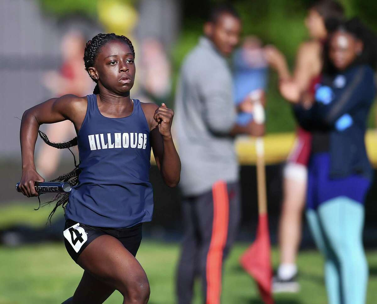 Hillhouse freshman Nyia White runs the first leg of the 4x400 relay at the SCC championship on Wednesday. White and her teammates, juniors Jada Boyd, De' Janay Davis and Nyimah Ambrose won the event in 3:59.59.