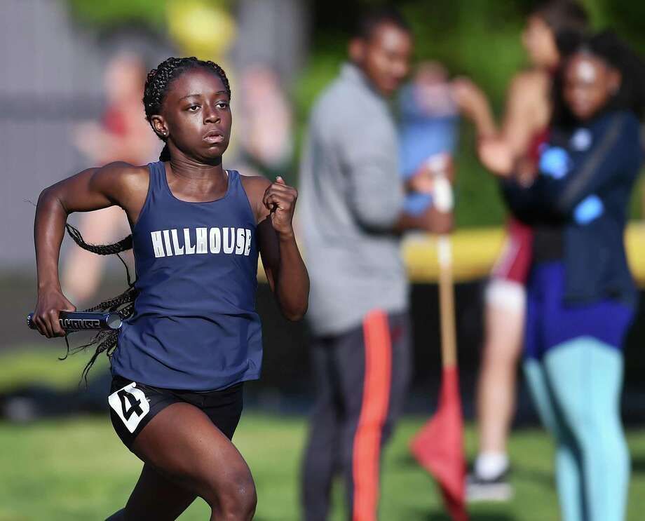 Hillhouse freshman Nyia White runs the first leg of the 4x400 relay at the SCC championship on Wednesday. White and her teammates, juniors Jada Boyd, De' Janay Davis and Nyimah Ambrose won the event in 3:59.59. Photo: Catherine Avalone / Hearst Connecticut Media / New Haven Register