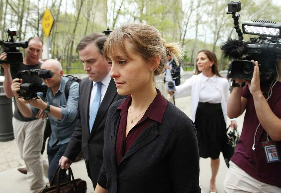 Actress Allison Mack departs the United States Eastern District Court after a bail hearing in relation to the sex trafficking charges filed against her on May 4, 2018 in the Brooklyn borough of New York City. The actress, known for her role on 'Smallville', is charged with sex trafficking. Along with alleged cult leader Keith Raniere, prosecutors say Mack recruited women to a upstate New york mentorship group NXIVM that turned them into sex slaves.  (Photo by Jemal Countess/Getty Images) Photo: Jemal Countess / 2018 Getty Images