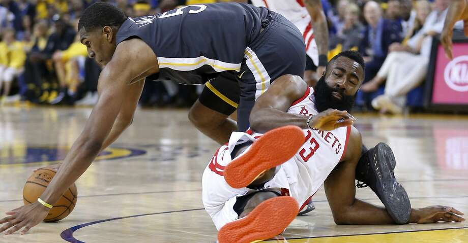 Golden State Warriors forward Kevon Looney (5) steals the ball from Houston Rockets guard James Harden (13) during the first half of Game 4 of the Western Conference Finals at Oracle Arena Tuesday, May 22, 2018 in Oakland. (Michael Ciaglo / Houston Chronicle) Photo: Michael Ciaglo/Houston Chronicle