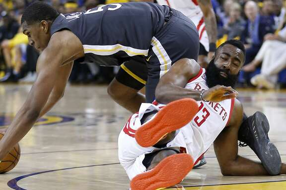 Golden State Warriors forward Kevon Looney (5) steals the ball from Houston Rockets guard James Harden (13) during the first half of Game 4 of the Western Conference Finals at Oracle Arena Tuesday, May 22, 2018 in Oakland. (Michael Ciaglo / Houston Chronicle)