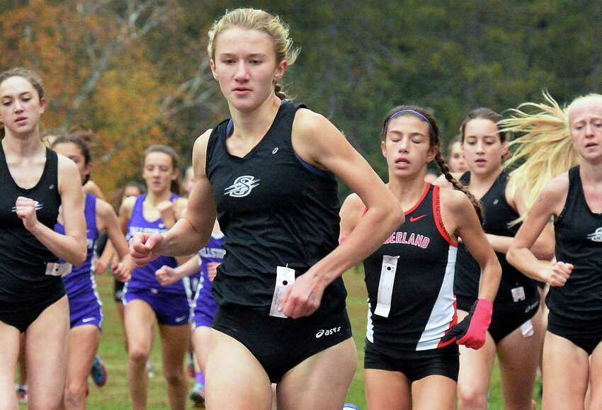 Saratoga High's Kelsey Chmiel, center, leads the pack on her way to winning Saturday's Suburban Council girl's varsity cross country championships Oct. 29, 2016 in Saratoga Springs, NY. (John Carl D'Annibale / Times Union)