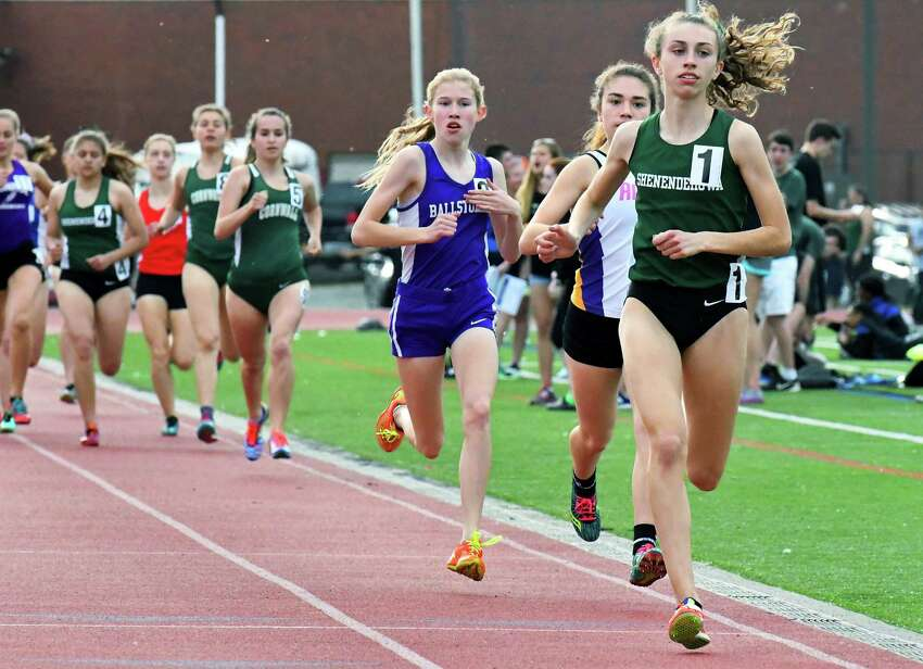 Shenendehowa's Hannah Reale, right, takes an early lead on her way to setting a meet record in the girls 1500m Shen Invitational track meet Friday May 12, 2017 in Clifton Park, NY. (John Carl D'Annibale / Times Union)