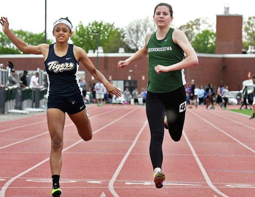Shenendehowa's Alexandra Tudor, right, beats Cohoes's Natalie Ricci during the Shen Invitational track meet Friday May 12, 2017 in Clifton Park, NY. (John Carl D'Annibale / Times Union)