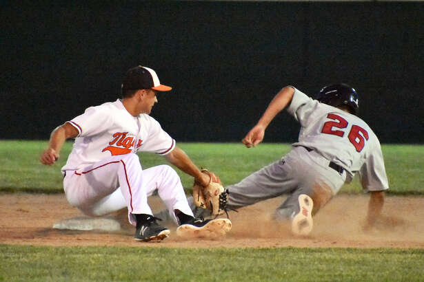 Edwardsville shortstop Josh Ohl, left, applies a tag to Alton's Simon Nguyen on a stolen base attempt. Nguyen was called safe.