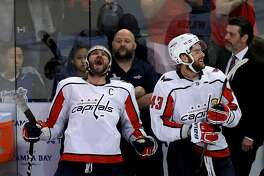 TAMPA, FL - MAY 23:  Alex Ovechkin #8 and Tom Wilson #43 of the Washington Capitals celebrate after defeating the Tampa Bay Lightning in Game Seven of the Eastern Conference Finals during the 2018 NHL Stanley Cup Playoffs at Amalie Arena on May 23, 2018 in Tampa, Florida. The Washington Capitals defeated the Tampa Bay Lightning with a score of 4 to 0.  (Photo by Mike Ehrmann/Getty Images)
