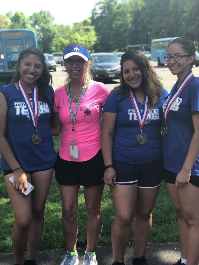Abbott Tech tennis players Ebelin Lalvay (left), Karen Pelaez (second from right) and Jesslyn Rodriguez (right), along with coach Shelley Visinski at the CTC championships, held at Wesleyan University in Middletown May 23, 2018. Photo: Contributed Photo / Contributed Photo
