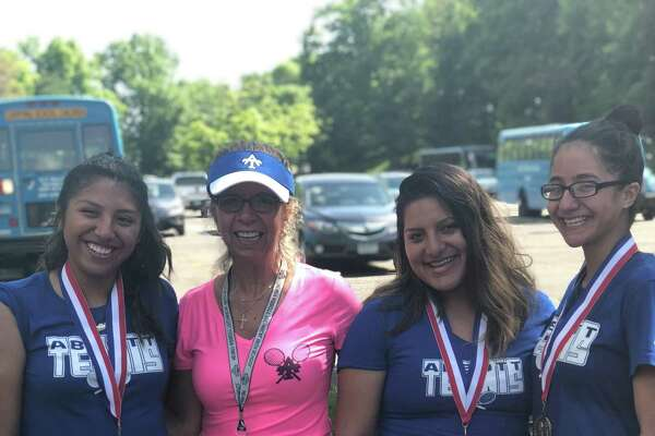Abbott Tech tennis playersEbelin Lalvay (left), Karen Pelaez (second from right) and Jesslyn Rodriguez (right), along withcoach Shelley Visinski at the CTC championships, held at Wesleyan University in Middletown May 23, 2018.
