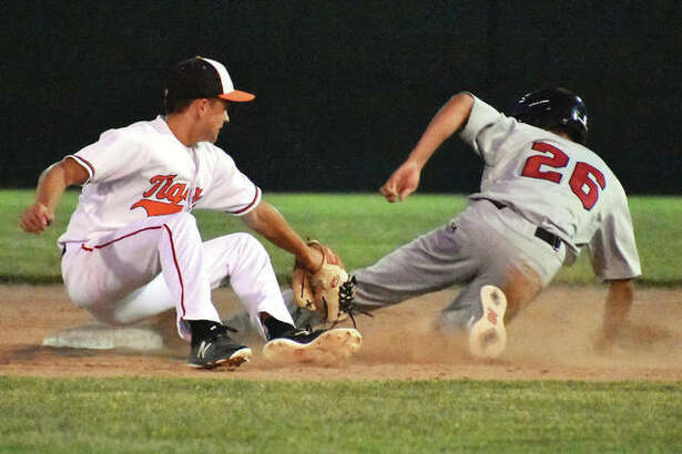 Edwardsville shortstop Josh Ohl (left) applies a tag to Alton's Simon Nguyen too late to get an out on a stolen base attempt Wednesday night at Tom Pile Field in Edwardsville.