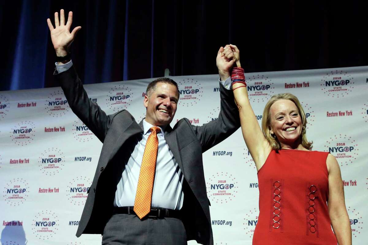 Dutchess County Executive Marc Molinaro, Republican candidate for governor, and Julie Killian, his running mate for lieutenant governor, acknowledge delegates' applause at the New York state Republican Convention, in New York, Wednesday, May 23, 2018. Delegates endorsed the 42-year-old Molinaro Wednesday at the GOP's state convention in Manhattan. He had faced a challenge for the nomination from state Sen. John DeFrancisco of Syracuse. (AP Photo/Richard Drew)