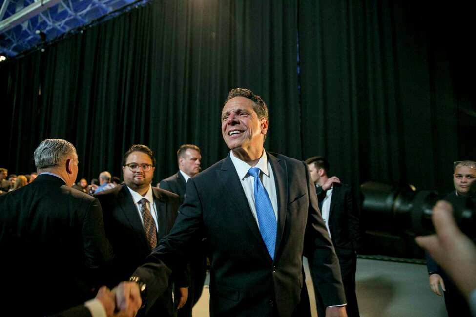 Gov. Andrew Cuomo speaks to reporters after receiving the endorsement of Hillary Clinton at the New York State Democratic Convention in Hempstead, N.Y., on Wednesday, May 23, 2018. With the might of incumbency and the state?'s Democratic machine at his back, Cuomo cruised toward his formal nomination for a third term on Wednesday. (Sam Hodgson/The New York Times)