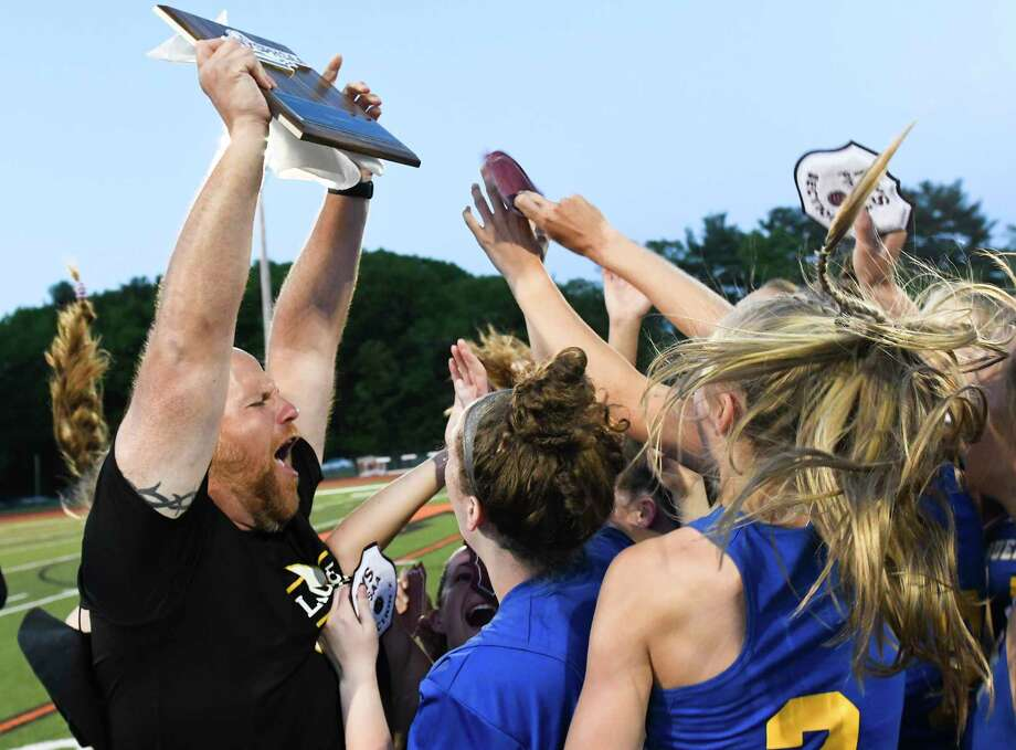 Queensbury head coach Dave Huth celebrates a  9-8 win with his players against  Niskayuna during a Section II Class B girls' lacrosse final Wednesday, May 23, 2018, in Rotterdam, N.Y. (Hans Pennink / Special to the Times Union) Photo: Hans Pennink / Hans Pennink