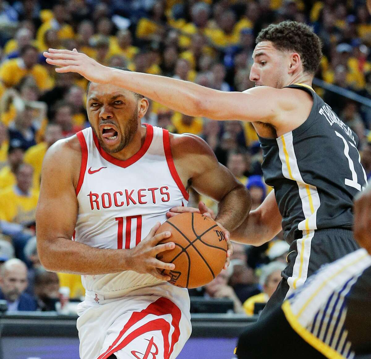 Houston Rockets' Eric Gordon tries to get past Golden State Warriors' Klay Thompson in the third quarter during game 4 of the Western Conference Finals between the Golden State Warriors and the Houston Rockets at Oracle Arena on Tuesday, May 22, 2018 in Oakland, Calif.