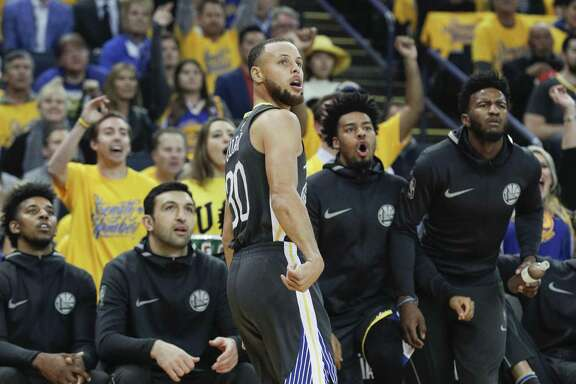 Golden State Warriors' Stephen Curry watches his three-pointer go in in the first quarter during game 4 of the Western Conference Finals between the Golden State Warriors and the Houston Rockets at Oracle Arena on Tuesday, May 22, 2018 in Oakland, Calif.