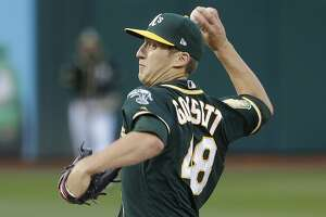 Oakland Athletics pitcher Daniel Gossett throws against the Seattle Mariners during the first inning of a baseball game in Oakland, Calif., Wednesday, May 23, 2018. (AP Photo/Jeff Chiu)