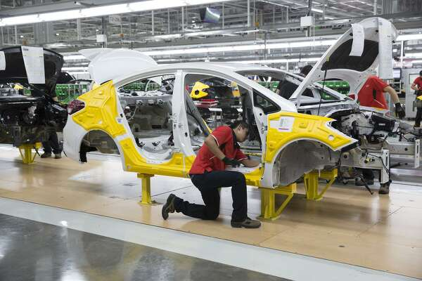 Kia Motors Corp. workers assemble Forte vehicles when the plant opened in Pesqueria, Mexico in 2016. That year, the plant was projected to build 80,000 Fortes to import to the U.S.