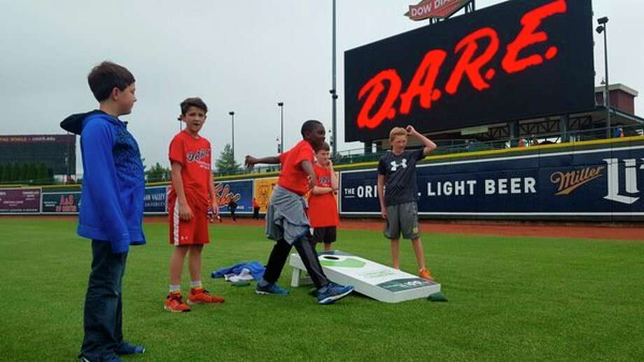 Students play during D.A.R.E. Day festivities Tuesday at Dow Diamond. (Kelly Dame/kdame@mdn.net)