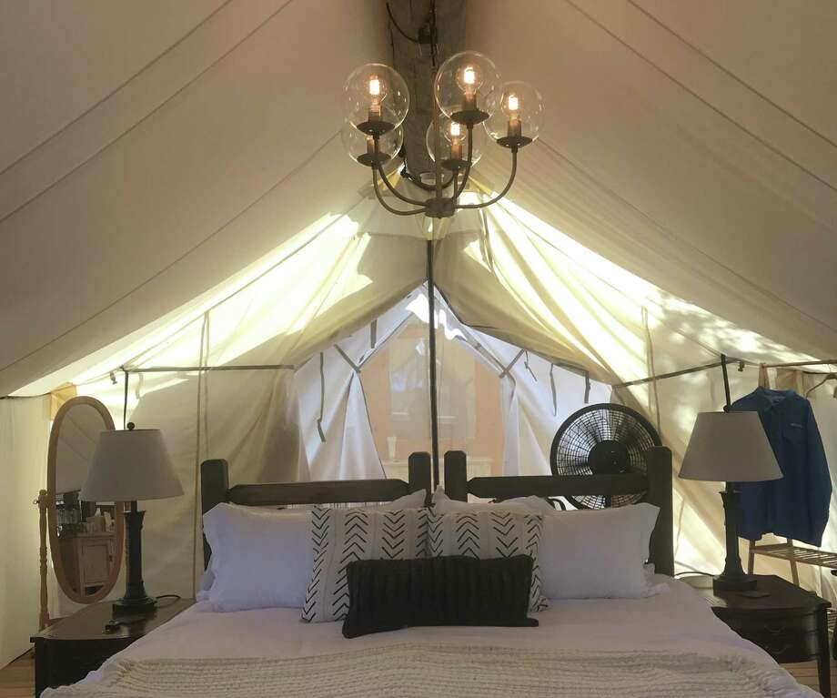 The canvas tent includes a king-size bed or two twins and plenty of room to walk around to enjoy the unique atmosphere. Photo: Terry Scott Bertling / San Antonio Express-News