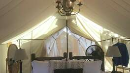 The canvas tent includes a king-size bed or two twins and plenty of room to walk around to enjoy the unique atmosphere.