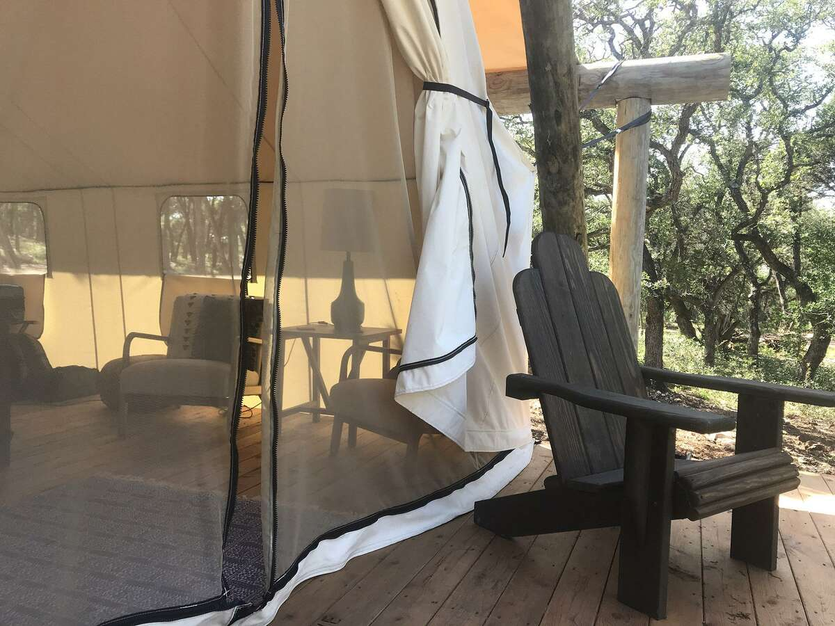 Zip-up screen doors on the front and back of the 16-by-20 canvas tents and several zip-up windows allow a breeze to cool the space. Adirondack chairs on the small deck are perfect for chilling with liquid refreshments you've brought along from the nearby wine country.