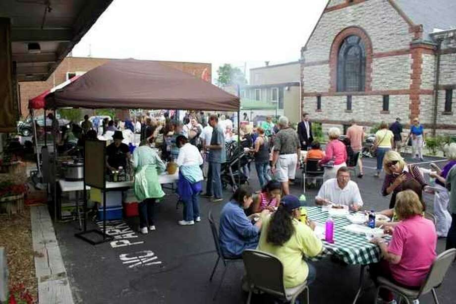 People gather and enjoy food from local vendors in the Castle Museum of Saginaw County's parking lot during Jazz on Jefferson. (Photo provided)