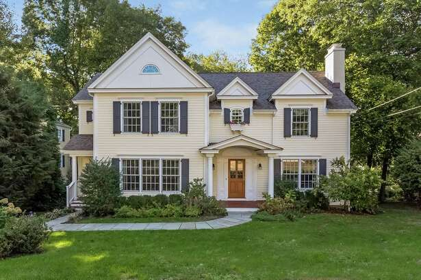 The yellow clapboard colonial house at 9 Edelweiss Lane has eight rooms and 3,324 square feet of living space.