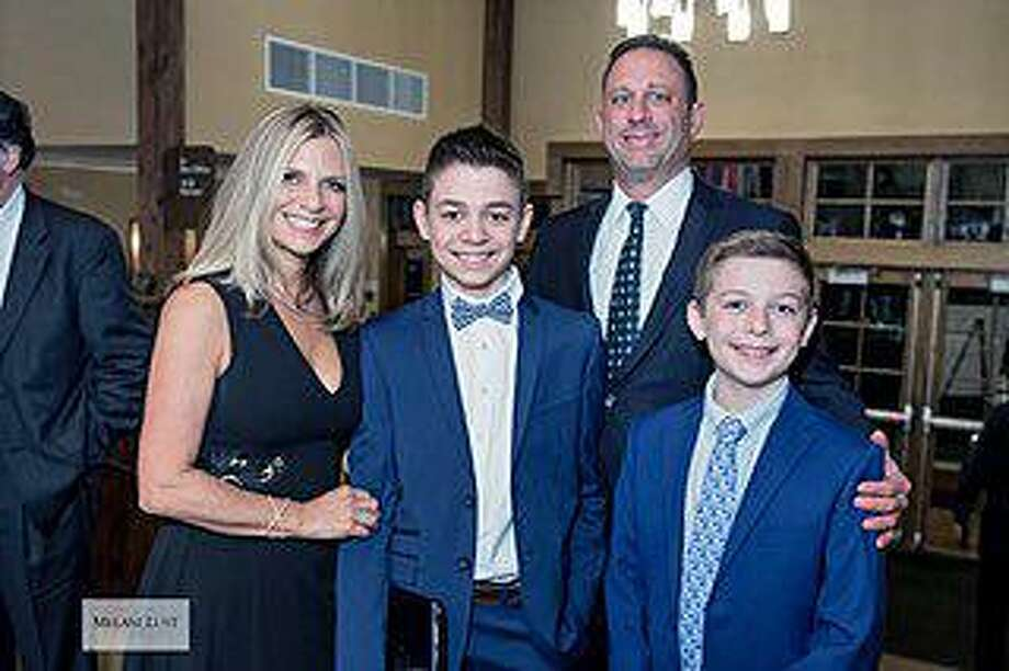 Fairfield 14-year-old Max Rosenberg with his family. Photo: Contributed Melani Lust Photography