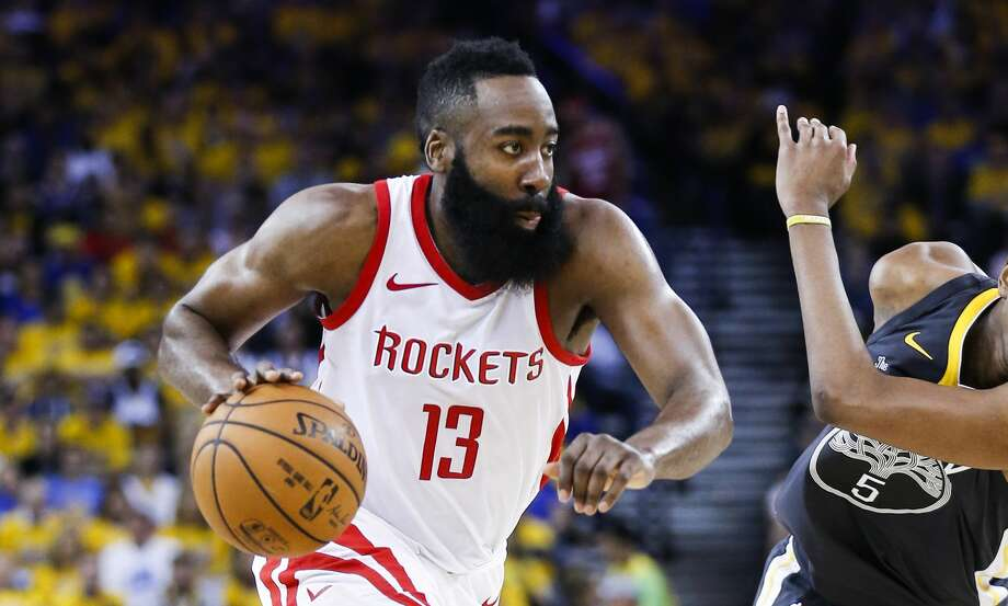 Houston Rockets guard James Harden (13) dribbles past Golden State Warriors forward Kevon Looney (5) during the first half of Game 4 of the Western Conference Finals at Oracle Arena Tuesday, May 22, 2018 in Oakland. (Michael Ciaglo / Houston Chronicle) Photo: Michael Ciaglo/Houston Chronicle
