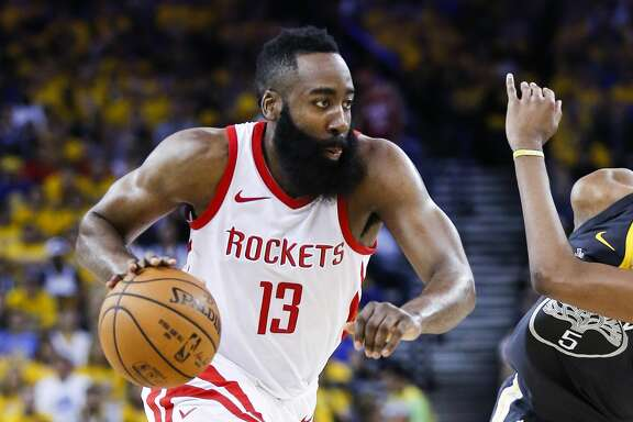 Houston Rockets guard James Harden (13) dribbles past Golden State Warriors forward Kevon Looney (5) during the first half of Game 4 of the Western Conference Finals at Oracle Arena Tuesday, May 22, 2018 in Oakland. (Michael Ciaglo / Houston Chronicle)