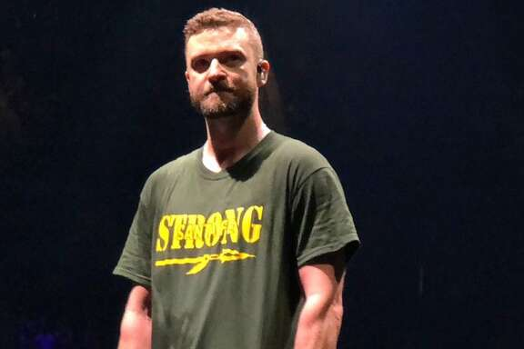 "Justin Timberlake closed his Houston concert on May 24, 2018 with a special message for the victims of the May 18 mass shooting at Santa Fe High School in Santa Fe, Texas. Wearing a ""Santa Fe Strong"" T-shirt, Timberlake told concertgoers ""we're gonna light the whole arena, this whole city up for Santa Fe High School."" (photo courtesy   Adam Busby on Twitter  )"