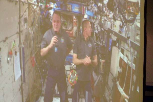 Astronauts     Ricky     Arnold     and     Drew     Feustel     converse     from     the     International     Space     Station     with     students     at     Liberty     Middle     School     via     Skype.