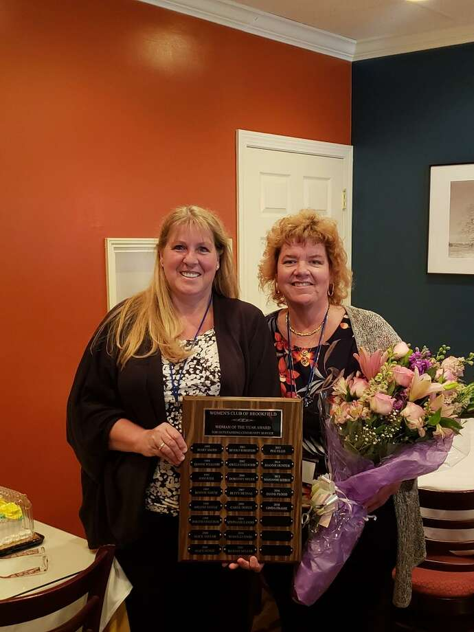 The Woman's Club of Brookfield named Linda Frame was named the Woman of the Year. Frame, right, with Diane Flood, left, a past Woman of the Year recipient. Photo: / Contributed Photo
