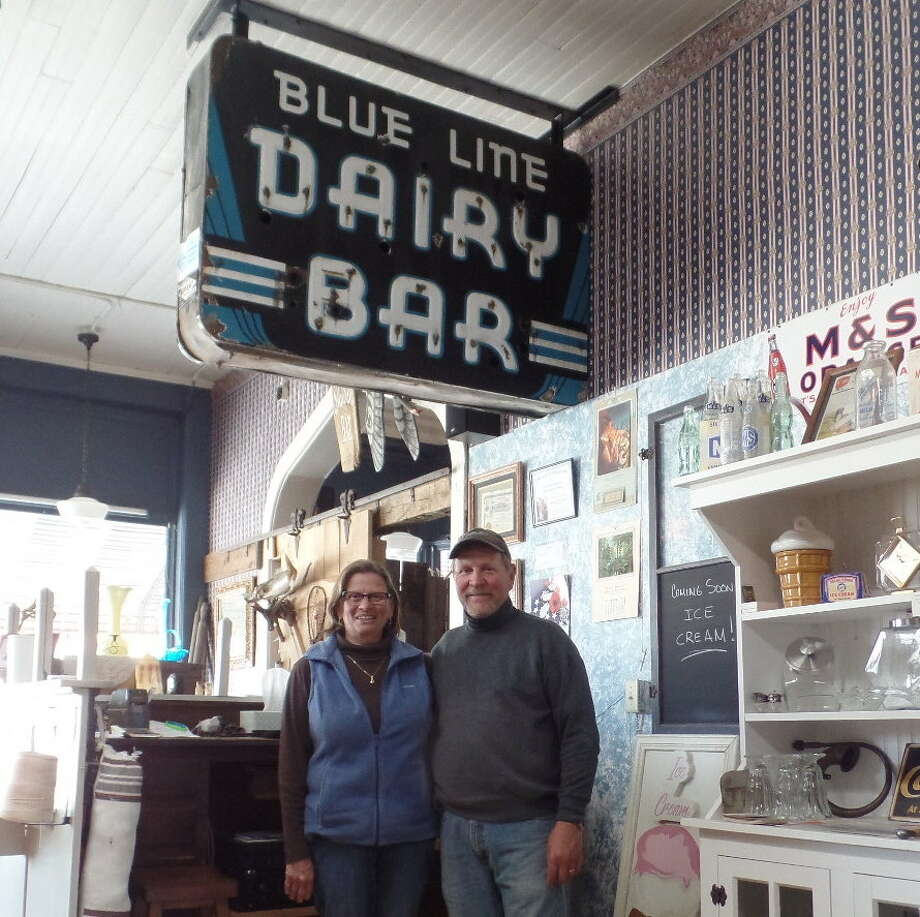 "One of Cornerstone Venture's prize displays is the ""Blue Line Dairy — Dairy Bar"" sign that used to hang over a malt shop on Union Street. Owners Chris and Doug Deming will soon serve ice cream treats at the antique store and museum. Photo: Mary Drier/For The Tribune / Copyright 2012"
