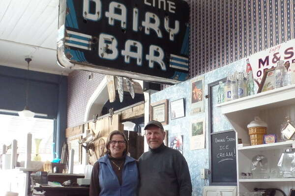 "One of Cornerstone Venture's prize displays is the ""Blue Line Dairy — Dairy Bar"" sign that used to hang over a malt shop on Union Street. Owners Chris and Doug Deming will soon serve ice cream treats at the antique store and museum."