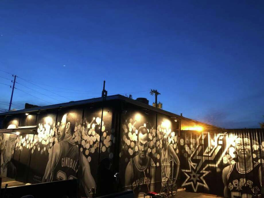Rudy's Seafood, a South Flores staple, commissioned Nik Soupè of Los Otros Murals to turn an exterior wall of the restaurant into a Silver & Black ode. The mural was completed this week with the addition of Tim Duncan and David Robinson. Photo: Courtesy, Roland Ramirez/Rudy's Seafood