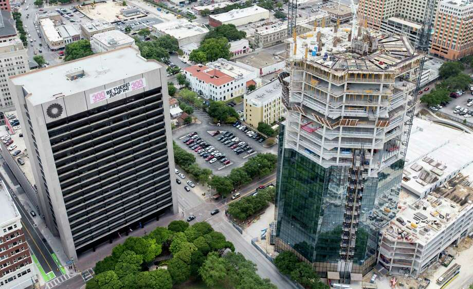 The still-under-construction Frost Tower rises Wednesday, May 23, 2018 in an aerial image to the right of the original Frost Tower. Photo: William Luther, San Antonio Express-News / © 2018 San Antonio Express-News