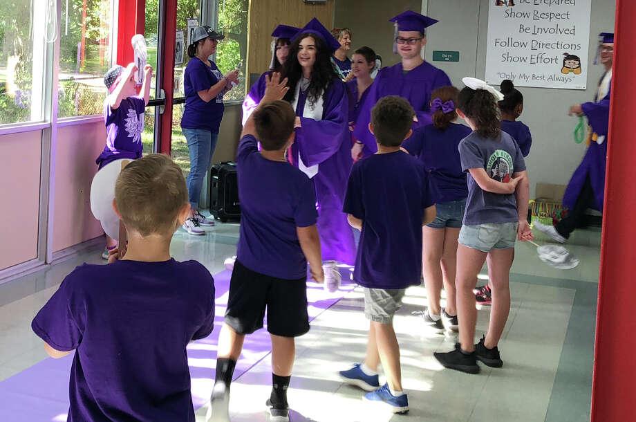 The 2018 Port Neches-Groves seniors walk through the halls of Woodcrest Elementary Thursday, May 24, 2018. Photo: Monique Batson/The Enterprise
