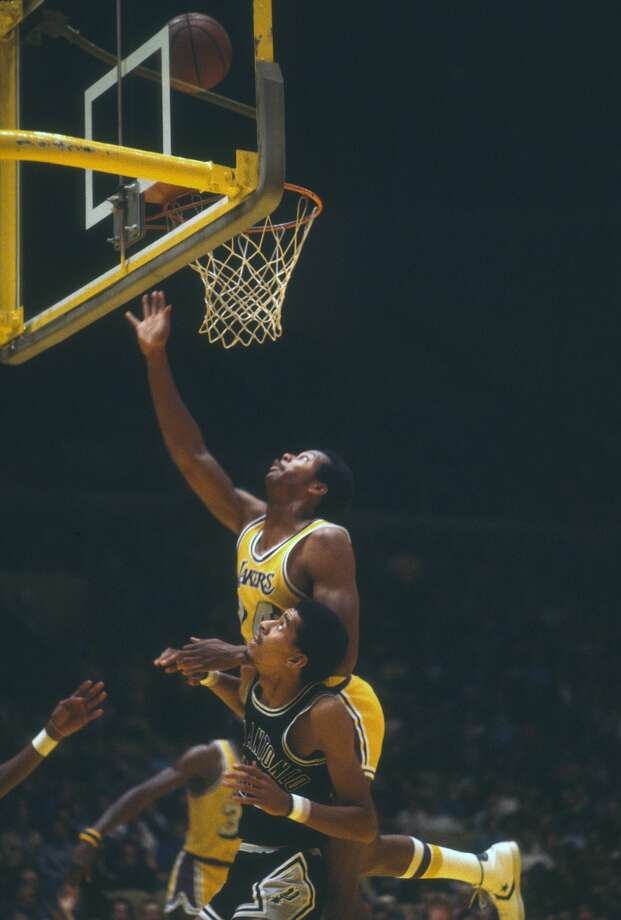 Kermit Washington (24) of the Los Angeles Lakers goes up for a rebound over the back of George Gervin (44) of the San Antonio Spurs during an NBA basketball game circa 1975 at the Forum in Inglewood, California. Washington played for the Lakers from 1973-77. Washington was sentenced Monday, July 9, 2018, in Kansas city, Mo., to 