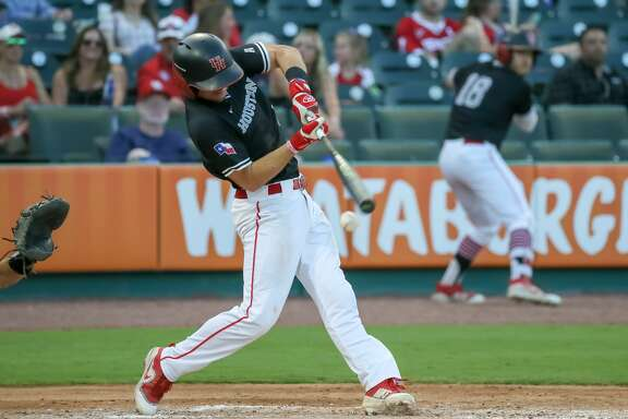 SUGAR LAND, TX - MAY 15:  Houston infielder Connor Hollis (5) connects with the ball during the Silver Glove series baseball game between the Rice Owls and Houston Cougars on May 15, 2018 at Constellation Field in Sugar Land, Texas.  (Photo by Leslie Plaza Johnson/Icon Sportswire via Getty Images)