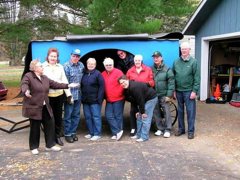 The 'worker bees' pose in front of the Pop-N-Pooh wagon before putting it in storagefor the winter. From leftarePat Pagel, Betty Cole, Dave andFlorence Sohacki, Karen Janczewski, Jim andJan Fry,Wendy Robertson, Phil KrahnandDale Cole. Mike Janczewski and Mary Banister are missing from the group. (Photo provided)