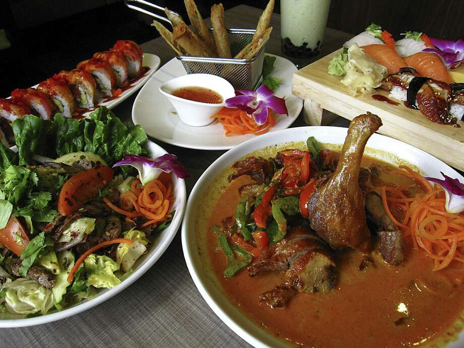 Yum nua Thai beef salad, left, Kin House Roll, Kin Spring Rolls, a nigiri selection and duck panang curry from Kin Thai & Sushi. Photo: Mike Sutter /San Antonio Express-News