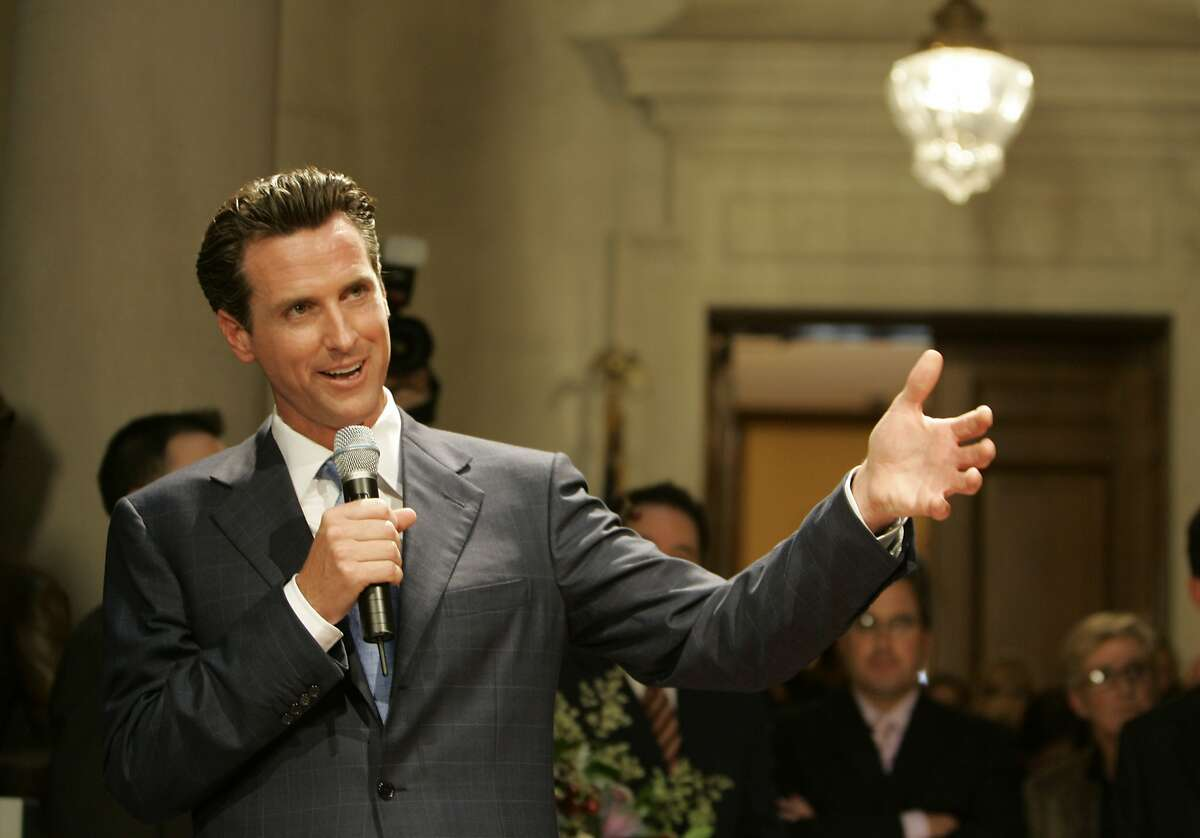 San Francisco Mayor Gavin Newsom answers questions outside his office at City Hall after legally marrying the first same-sex couple in San Francisco, Monday, June 16, 2008. Dozens of gay couples were married Monday after a landmark ruling making California the second state to allow same-sex nuptials went into effect. (AP Photo/Eric Risberg)