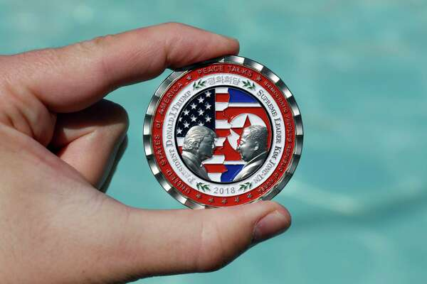 "A commemorative coin released by the White House for the now called-off ""peace summit,"" featuring the names and silhouettes of U.S. President Donald Trump and North Korean leader Kim Jung Un."