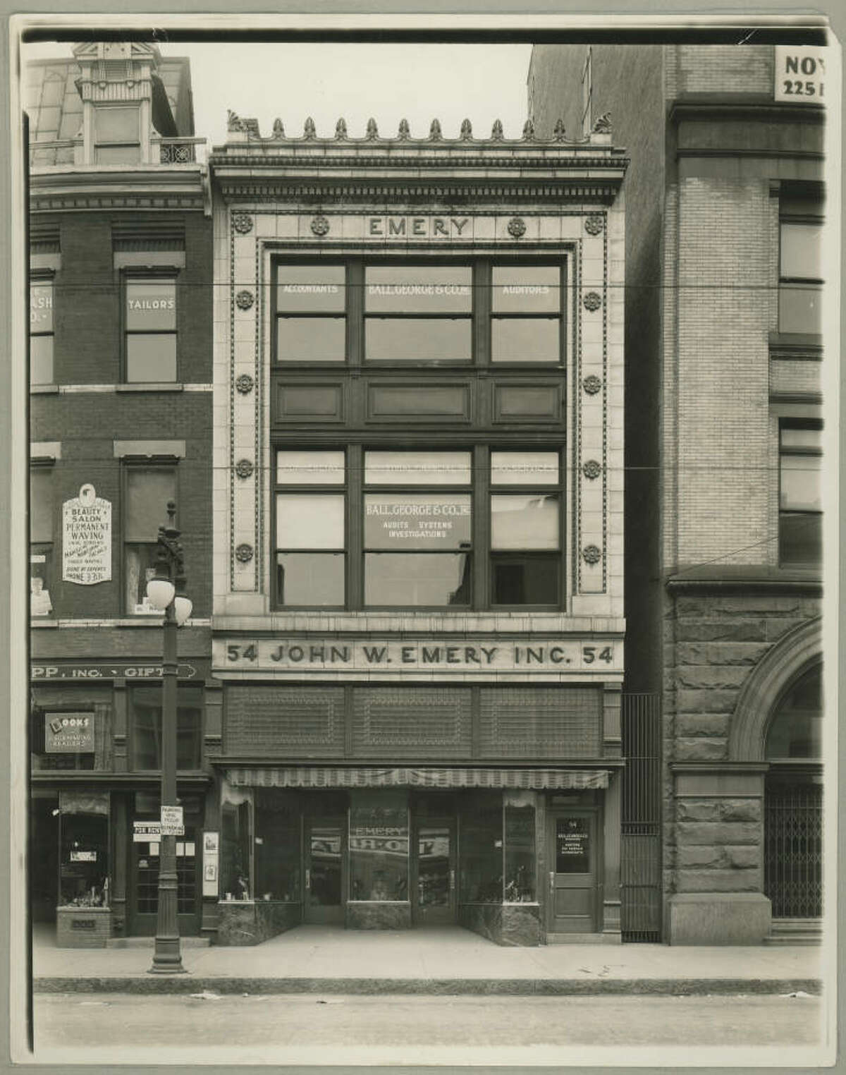 The former John W. Emery shoe store during the 1920s. A developer plans to convert the now-vacant building into apartments and retail shops.