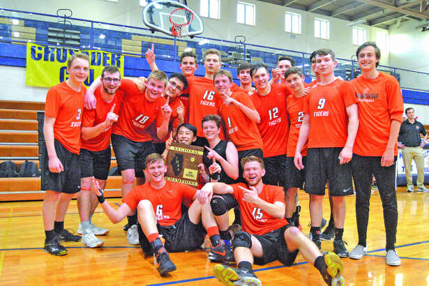 The Edwardsville boys' volleyball team poses with the Belleville Althoff Regional championship plaque after knocking off the Crusaders in three games Wednesday in Belleville.